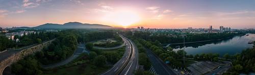 sunrise city cityscape nanjing urban greatwall lake mountain cloud sky skyline landscape nature highway transportation tree plant drone aerial spring panorama dawn twilight fog horizon