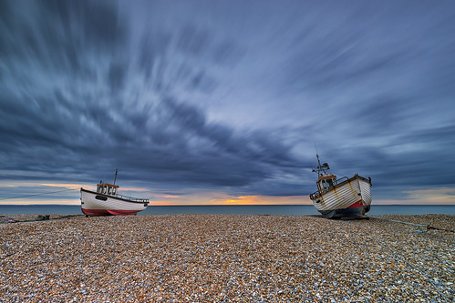 dungeness kent seaside seascape boats sunrise sky clouds longexposure pebbles beach orange blue