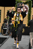 """A graduate smiles and throws a shaka as he walks off stage with his diploma at the commencement ceremony on Friday, May 11, 2018.   Go the Hawaii Community College's Flickr album for more photos from the Hilo ceremony: <a href=""""https://www.flickr.com/photos/53092216@N07/albums/72157696831286925/with/41216251825/"""">www.flickr.com/photos/53092216@N07/albums/721576968312869...</a>"""