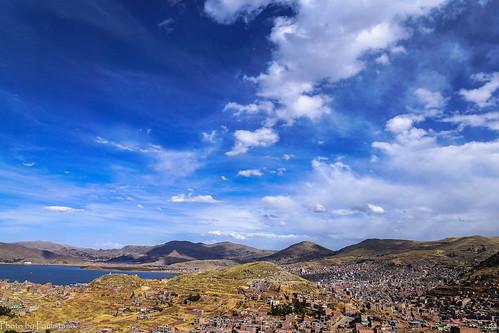 travel peru andes sky cloud altiplano lake titicaca puno city landscape mountains