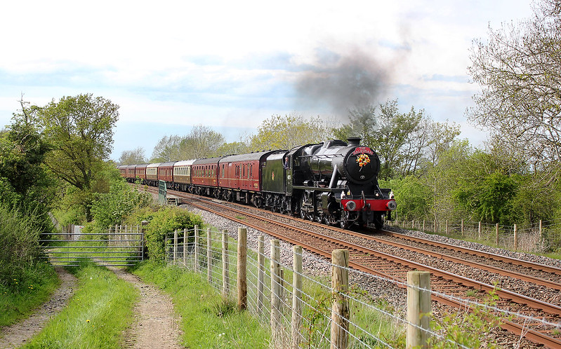 West Coast stalwart 8F, No.48151 heads the return Dalesman past Scotby Shield displaying a wreath on the smokebox door in memory of Albert Seymour, a renowned locomotive driver who recently passed away.  No water was taken at Appleby on the return, due to the ongoing dispute with WCRC and MSLO, and the 8F ran all the way to Hellifield non-stop.