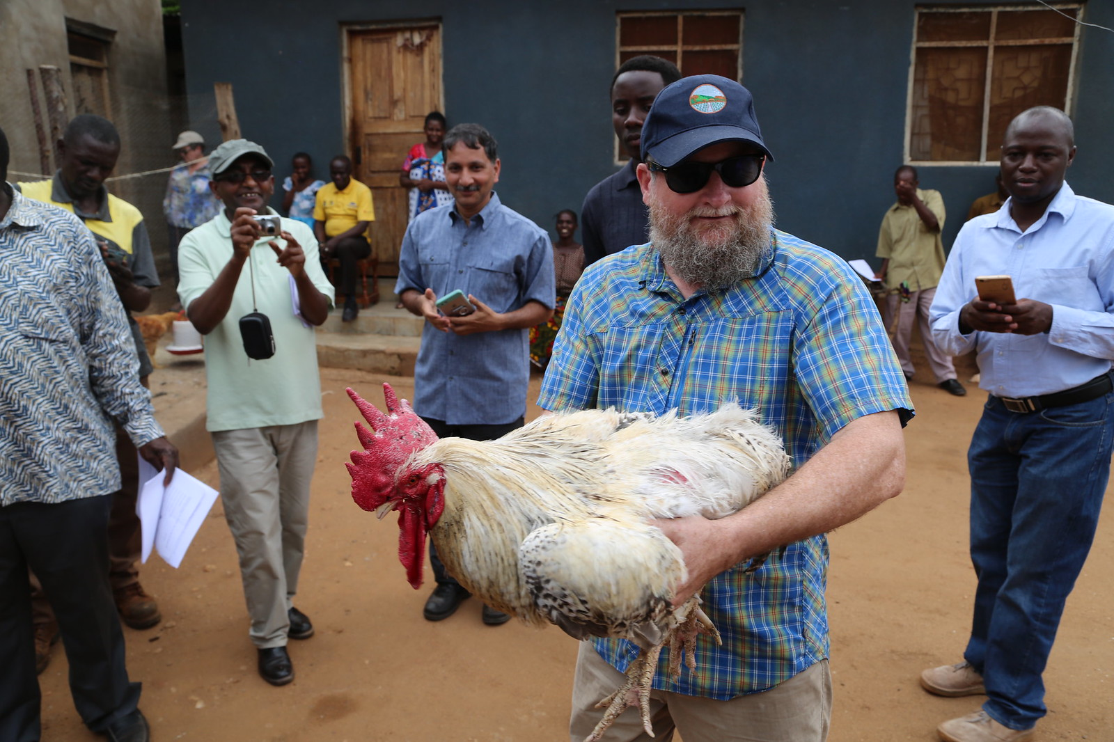 Jerry Glover holding a cock (one of the improved breeds) weighing 5.5 kg!
