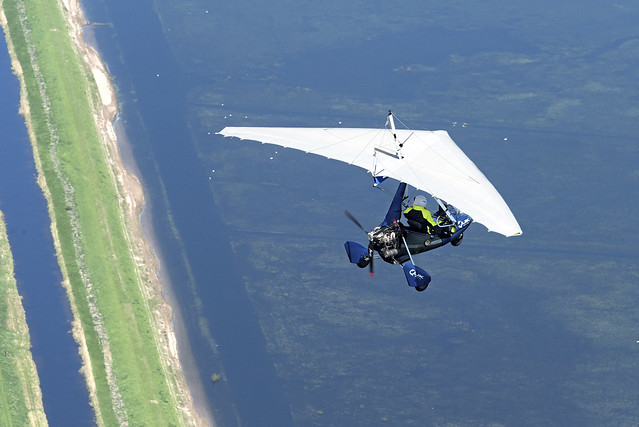 Quick flexwing microlight coasting out across the mighty Old Bedford River