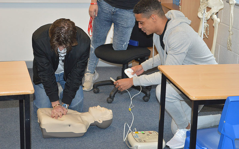 Bradford City youngsters receive a Cardiac Health workshop from Tobi Alabi of Heart4More Foundation