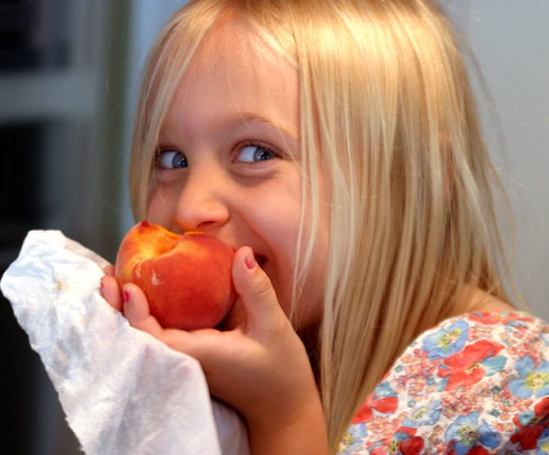 Grayson, our granddaughter, eating a Georgia  peach and enjoying every bite. | by Bruce Tuten